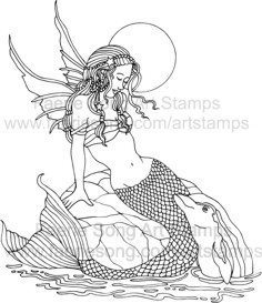 Mermaid Fairy sitting on a rock in the moonlight with dolphin