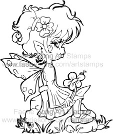 Sweet Pixie sitting on a rock holding a flower